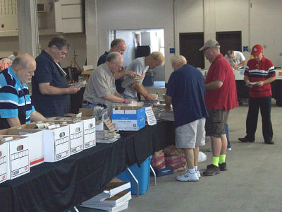 Bargain hunters looking through the dollar map boxes at the 2013 RMCA meet.